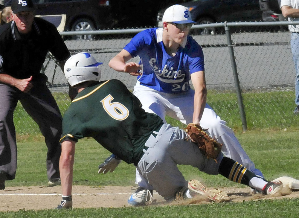 Erskine's Noah Bonsant tags out Mt. Desert Island runner Jacob Mitchell during a Class B North quarterfinal game last spring in South China.