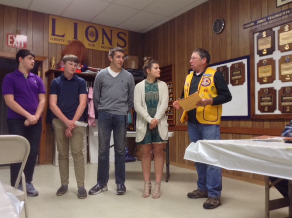 Leo Club officers, from left, are Miles Nored, Hunter Rushing, Harrison Mosher and Morgan Emond, with Whitefield Lions Club member Barry Tibbetts. Missing from photo is Leo Club officer Samantha Heath.