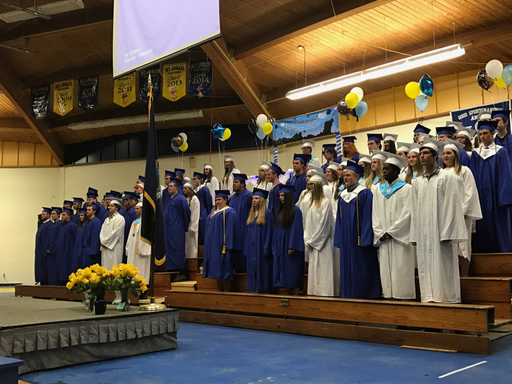 Mt. Abram's graduating class of 2017 stands during commencement on Friday night at Mt. Abram High School in Strong.