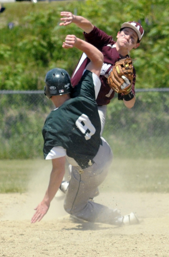 Staff photo by Joe Phelan   Monmouth second baseman Matt Foulk throws to first as Winthrop baserunner Matt Ingram slides into him during a game-ending double play in a Class C South semifinal Saturday afternoon in Winthrop.