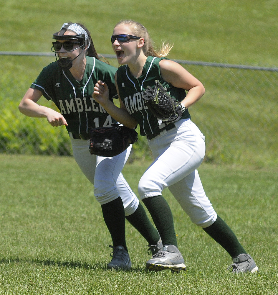 Staff photo by Joe Phelan   Winthrop second baseman Moriah Hajduk, left, and outfielder Maria Dostie celebrate after Dostie caught a fly ball to record the last out of a Class C South semiinal game against rival Monmouth on Saturday.