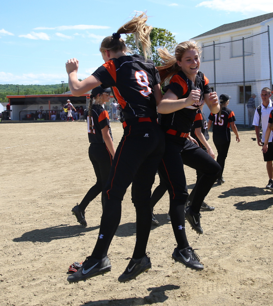 Members of the Skowhegan softball team celebrate after they defeated Bangor 12-0 in a Class A North semifinal Saturday in Skowhegan.