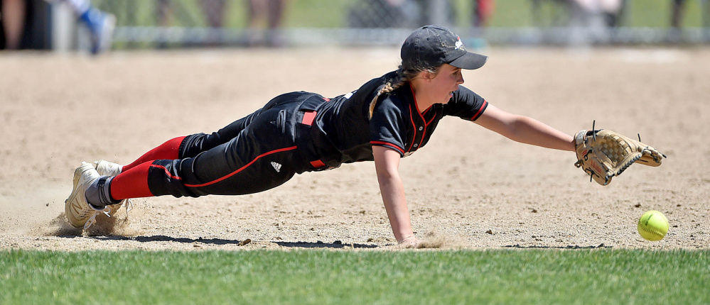 Lisbon's Brittany Norman dives for a grounder off the bat of Madison hitter Madeline Wood during a Class C South semifinal Saturday afternoon in Madison.