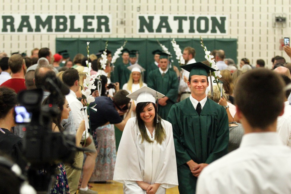 Alyxis Torrez and Bennett Brooks march in the processional during commencement exercises at Winthrop High School on Sunday.