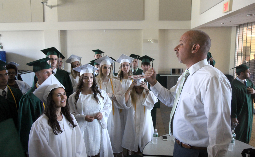 Winthrop High School Principal Keith Morin gives some last-minute instructions prior to graduation exercises on Sunday.
