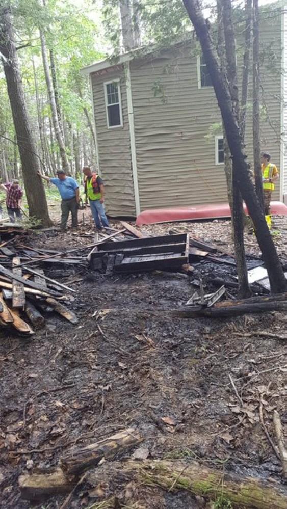 State forest rangers and firefighters from several departments, including Canaan's, responded to a fire on Sibley Pond where two buildings were damaged.