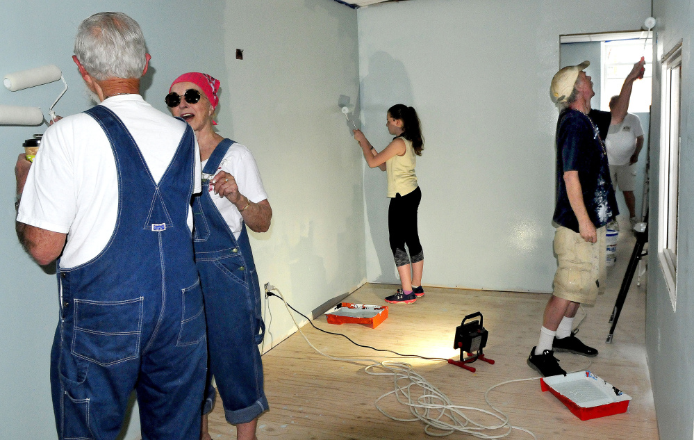 REM volunteers, including, from left, George Armstrong, Marie Cormier, Julia Sinclair and Mark Fairman, paint the new REM offices Tuesday on Temple Street in Waterville.