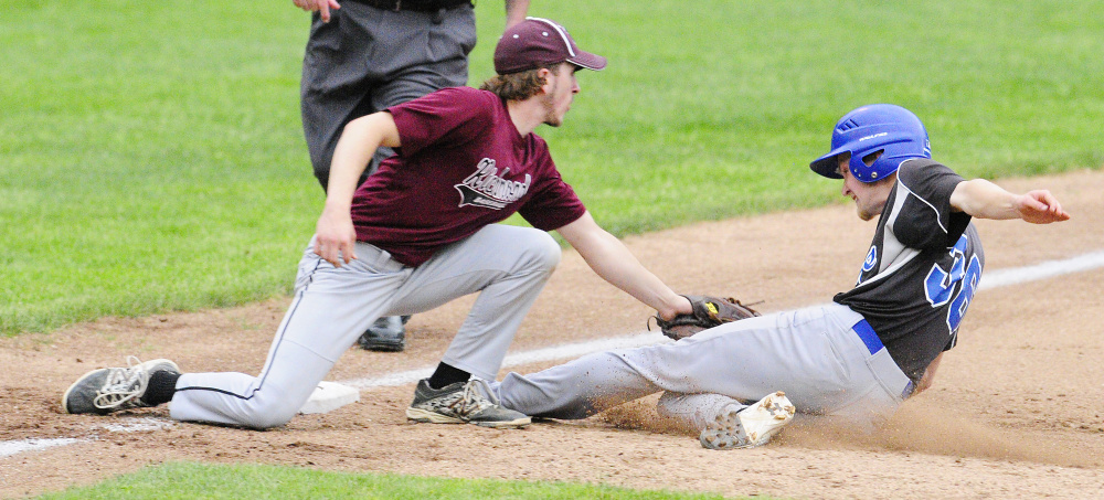 Staff photo by Joe Phelan   Richmond third baseman Brady Johnson tags out Searsport's Liam MacMillan during the Class D South regional final Tuesday at St. Joseph's College in Standish.
