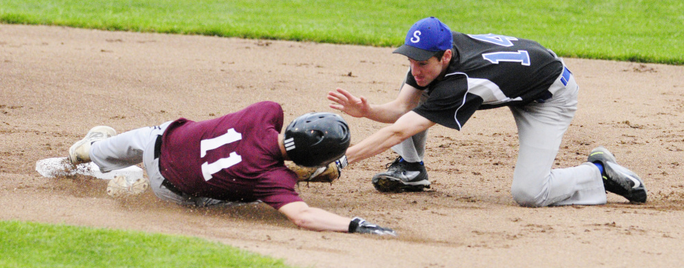 Staff photo by Joe Phelan   Richmond's Nate Kendrick, left, safely slides into second avoiding the tag of Searsport shortstop Colby Snow during the Class D South regional final Tuesday at St. Joseph's College in Standish.