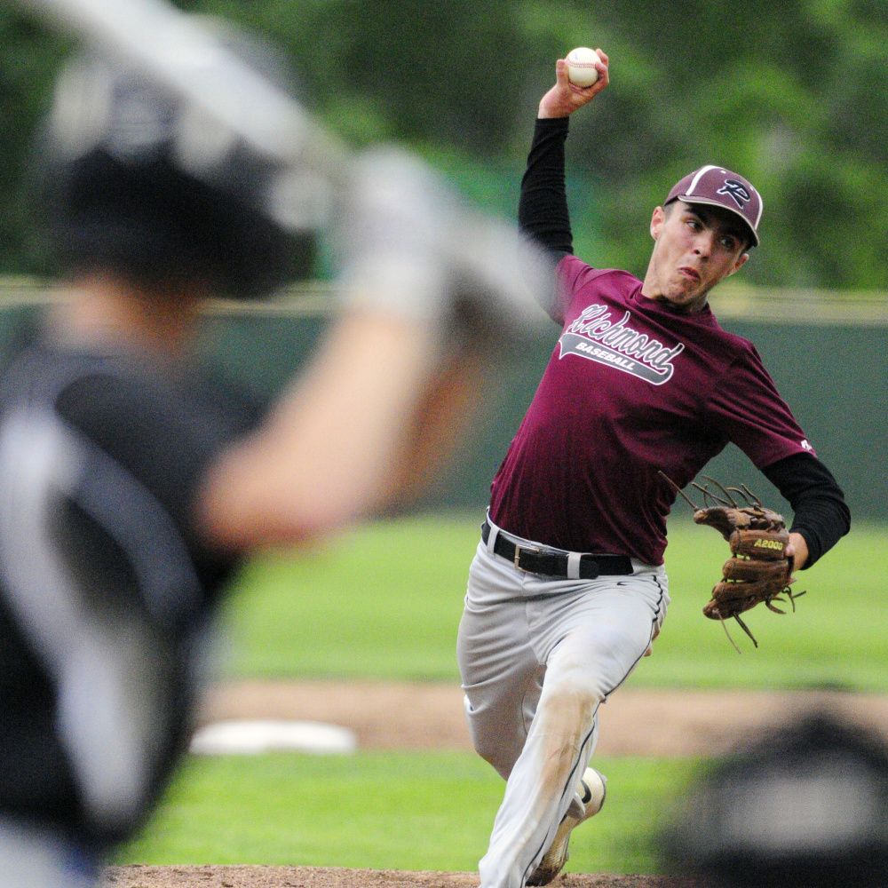 Staff photo by Joe Phelan   Richmond's Zach Small delivers a pitch to Searsport during the Class D South regional final Tuesday at St. Joseph's College in Standish.