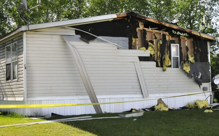 Police tape surrounds a mobile home at 13 Gold St. in the Evergreen Terrace mobile home park in Clinton. The mobile home was damaged by a fire that broke out late Tuesday night.