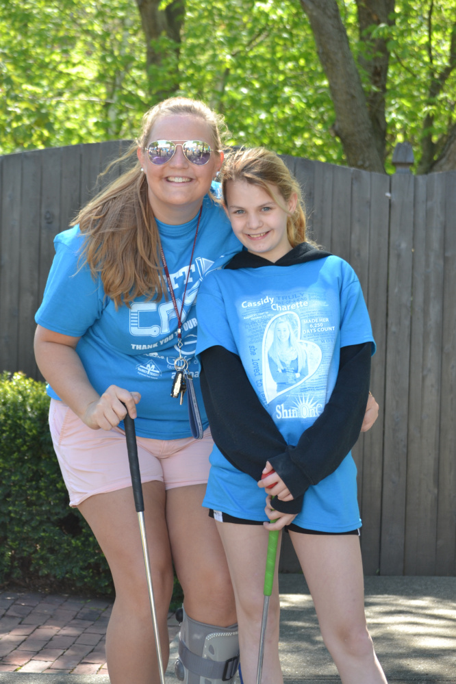 """Big Sister"" Anna Dobos and her ""Little Sister"" Delaney Bickford were among the 250 people who attended Big Brothers Big Sisters of Mid-Maine's first ""Putt 4 Cass"" event May 20 at Gifford's Famous Ice Cream and Mini Golf in Waterville. The event, held in memory and honor of Cassidy Charette, raised more than $25,000 to support local BBBS school-based mentoring programs."