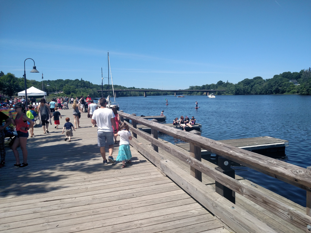 Locals stroll along the waterfront during last year's Greater Gardiner River Festival.