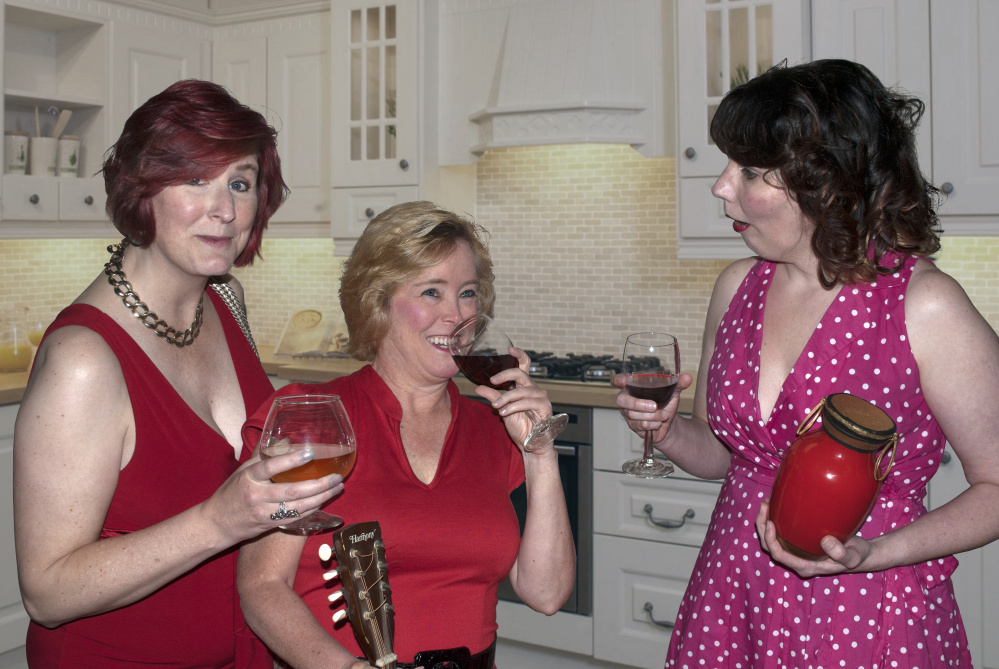 "Juli Brooks (Leona), left, Jeralyn Shattuck (Millie) and Elizabeth Chasse-King (Connie) bond over wine in a scene from ""Exit Laughing."""