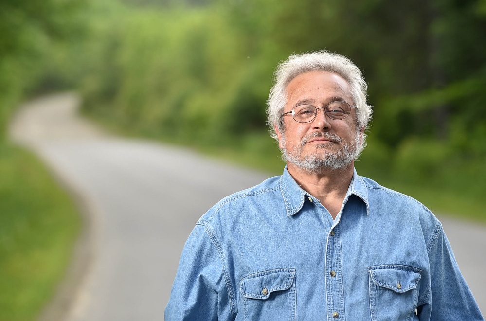 Bruce Keezer stands at 129 Goodrich Road in Clinton, where he lives, on Thursday. Keezer relies on the Kennebec Valley Community Action Program to get to Waterville from his rural home in Clinton for medicine and other supplies.