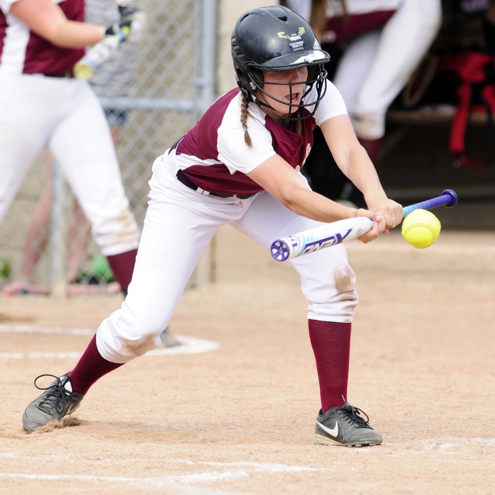 Staff photo by Joe Phelan Richmond shortstop Caitlin Kendrick tries to get a bunt down during the Class D South regional final Tuesday at St. Joseph's College in Standish.