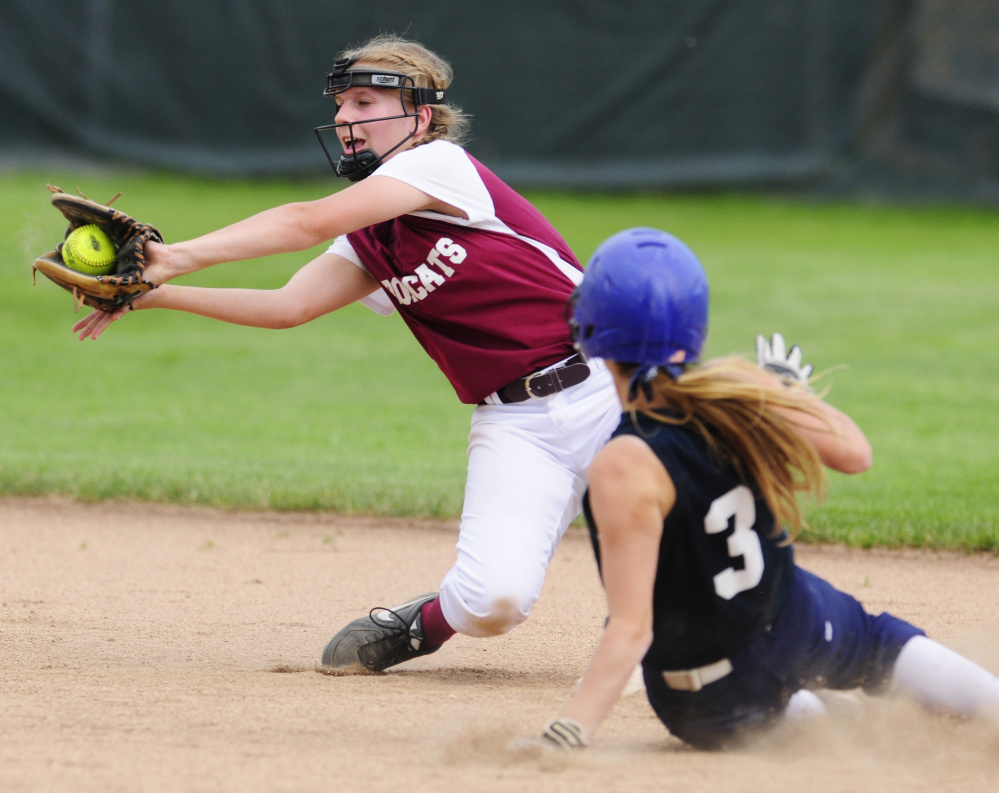 Greenville's Jessica Pomerleau slides safely into second base as Richmond shortstop Caitlin Kendrick catches the ball during the Class D South regional final Tuesday at St. Joseph's College in Standish.