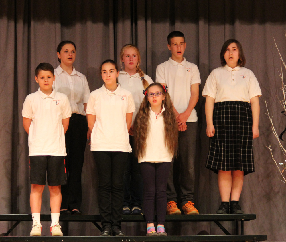 """Over the Rainbow"" was performed by Autumn Pacheco and the chorus. In front, from left, are Mason Desjardins, Madison Rohr and Carli Frigon. In back, from left, are Hannah Harmon, Hailey Welch, Jackman Daigle and Autumn Pacheco."