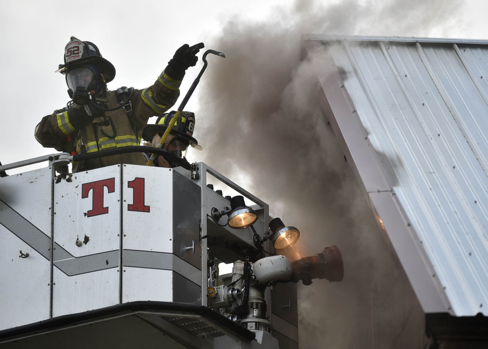 Firefighters from multiple agencies put out an apartment house fire Thursday at 11 High St. in Waterville.
