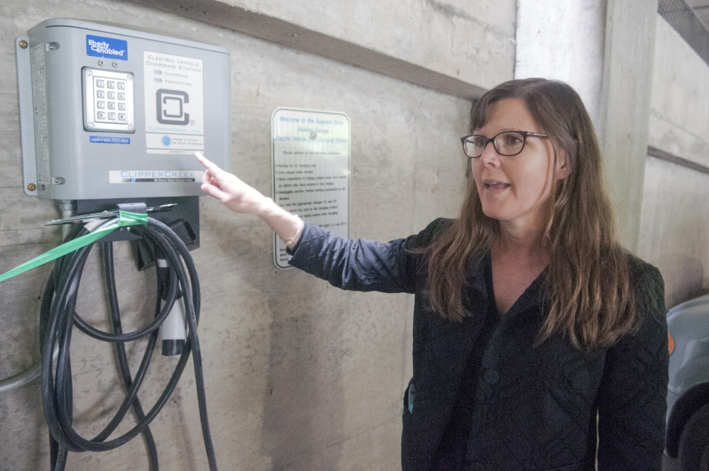 Jennifer Brennan, of the Greater Portland Council of Governments, talks about the new chargers for electric cars Friday in the State House parking garage in Augusta.