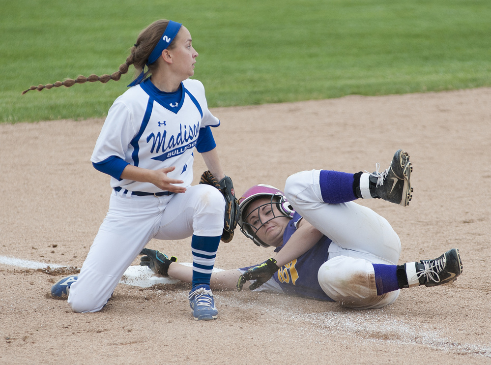 Kevin Bennett photo   Madison's Annie Worthen tags Bucksport runner Kylee Atwood out as she was caught off third base during fifth inning in the Class C state championship Saturday in Brewer.