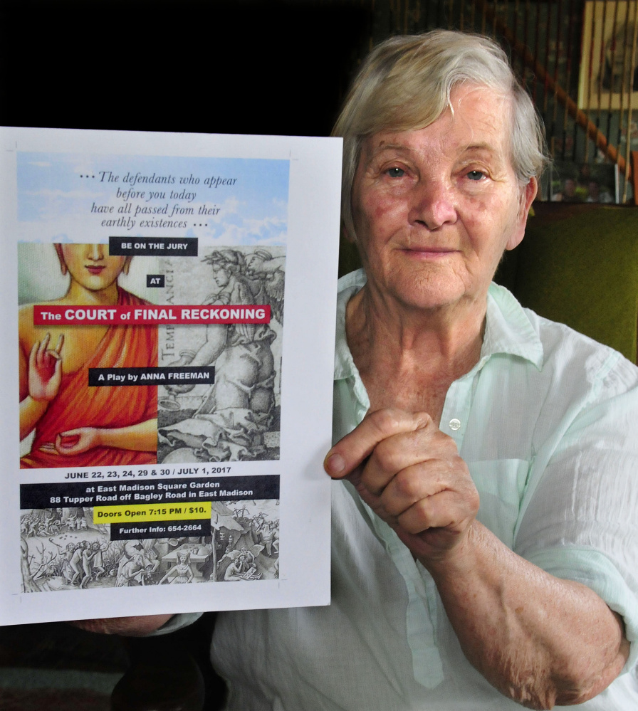 "Anna Freeman holds a poster for her play ""The Court of Final Reckoning"" that she wrote and will direct at the East Madison Square Garden on June 22-24 and June 29-July 1."