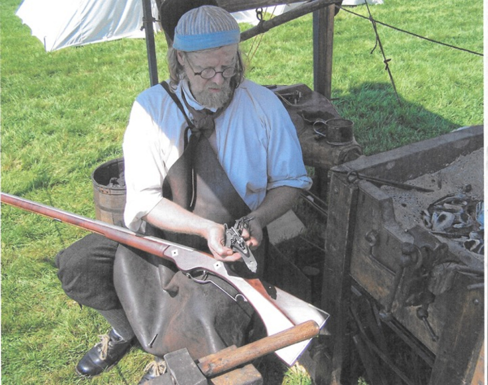 Blacksmith Jeff Miller works at his temporary forge.