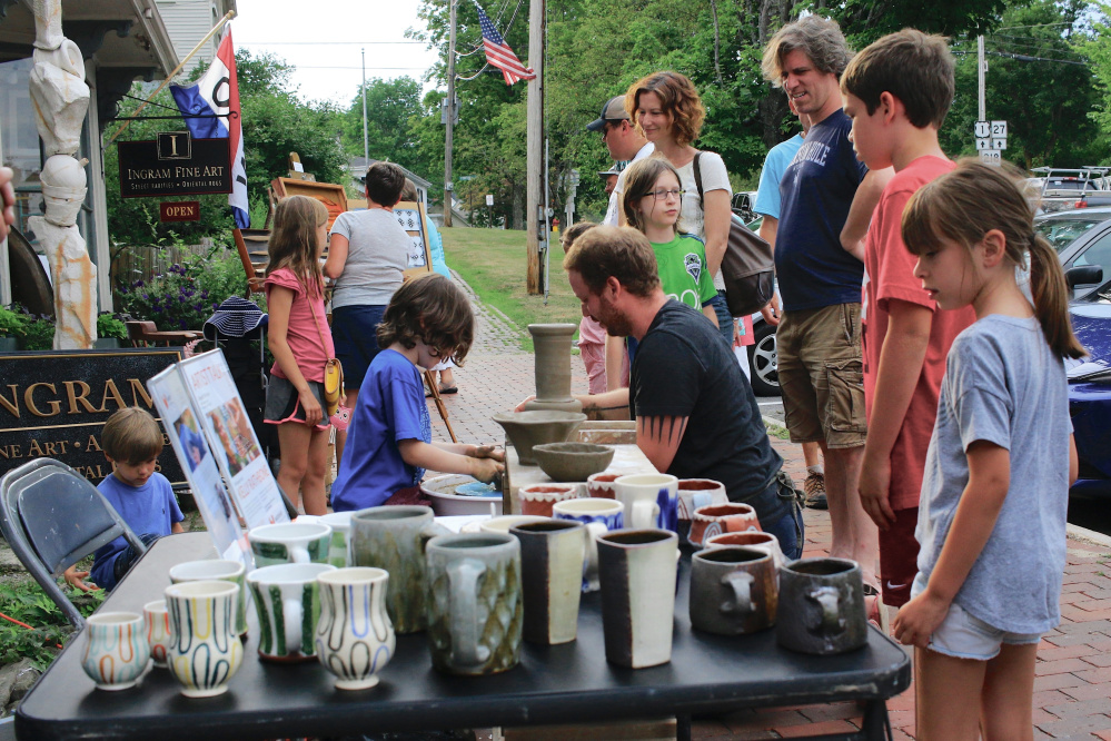 Frank Barnako gives a Watershed Center for the Ceramic Arts demonstration during a past Wiscasset Art Walk. The first 2017 art walk is on June 29.