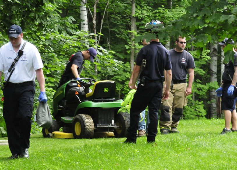 Waterville firefighters helped pull an injured man from a wooded area Wednesday after the lawn mower he was riding toppled down an embankment at 1 Ashley Terrace in Waterville.