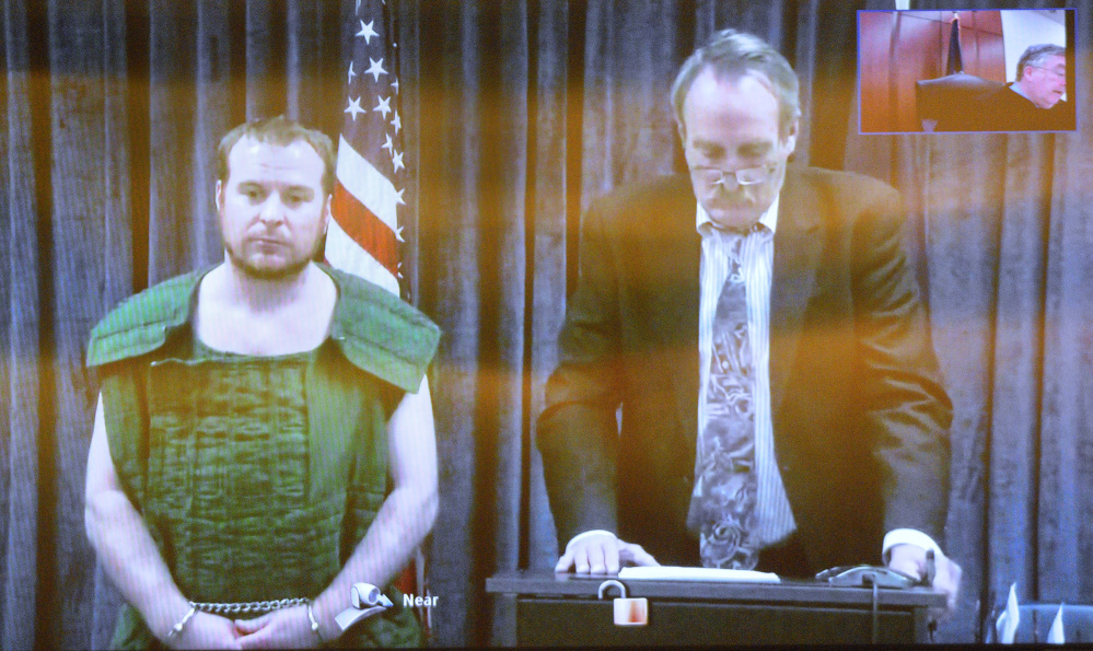 Jeremy Clement, left, and his attorney, Steve Bourget, appear on video from the Kennebec County jail during his initial appearance April 21 in the Capital Judicial Center in Augusta.