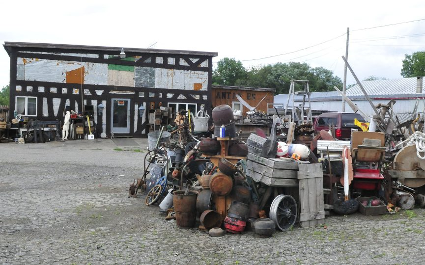 Used household items are stacked in front of the 201 Antiques store in Fairfield on Wednesday.