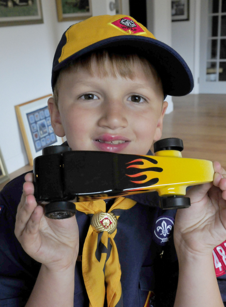 Cub Scout Trevor Russell, 8, of North Anson, shows his entry in the 2017 World Championship Pinewood Derby competition on Wednesday. The competition is being held in Times Square in New York City.