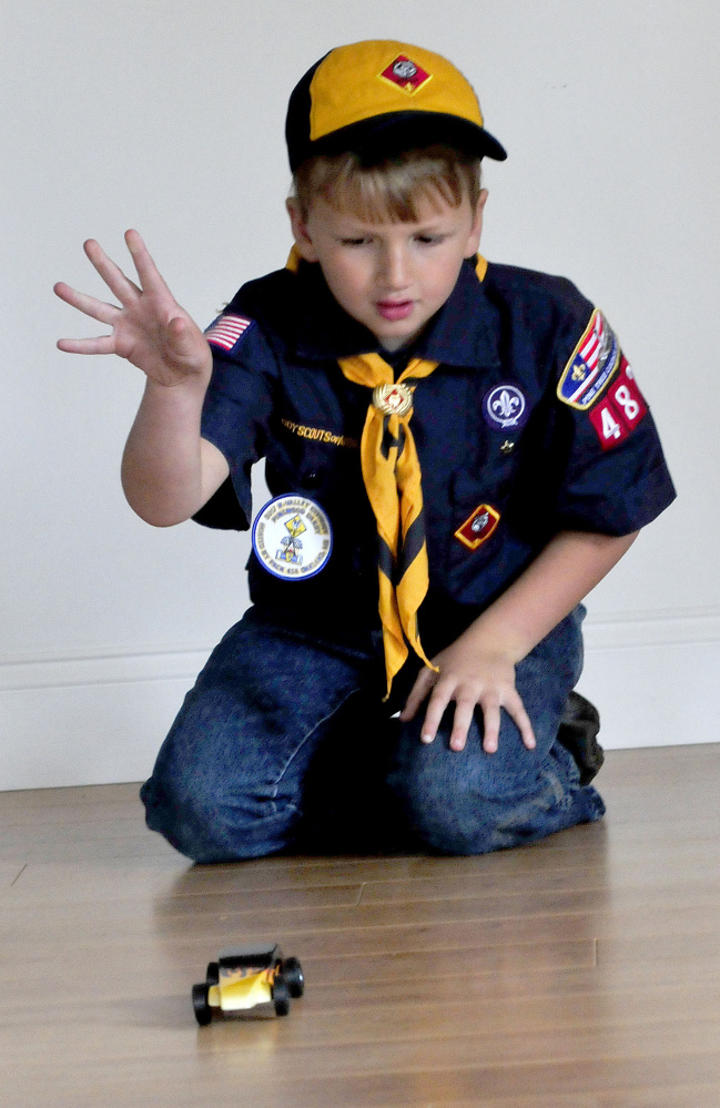 Cub Scout Trevor Russell, 8, of North Anson, gives his entry in the 2017 World Championship Pinewood Derby competition a spin on Wednesday. The competition is being held in Times Square in New York City.