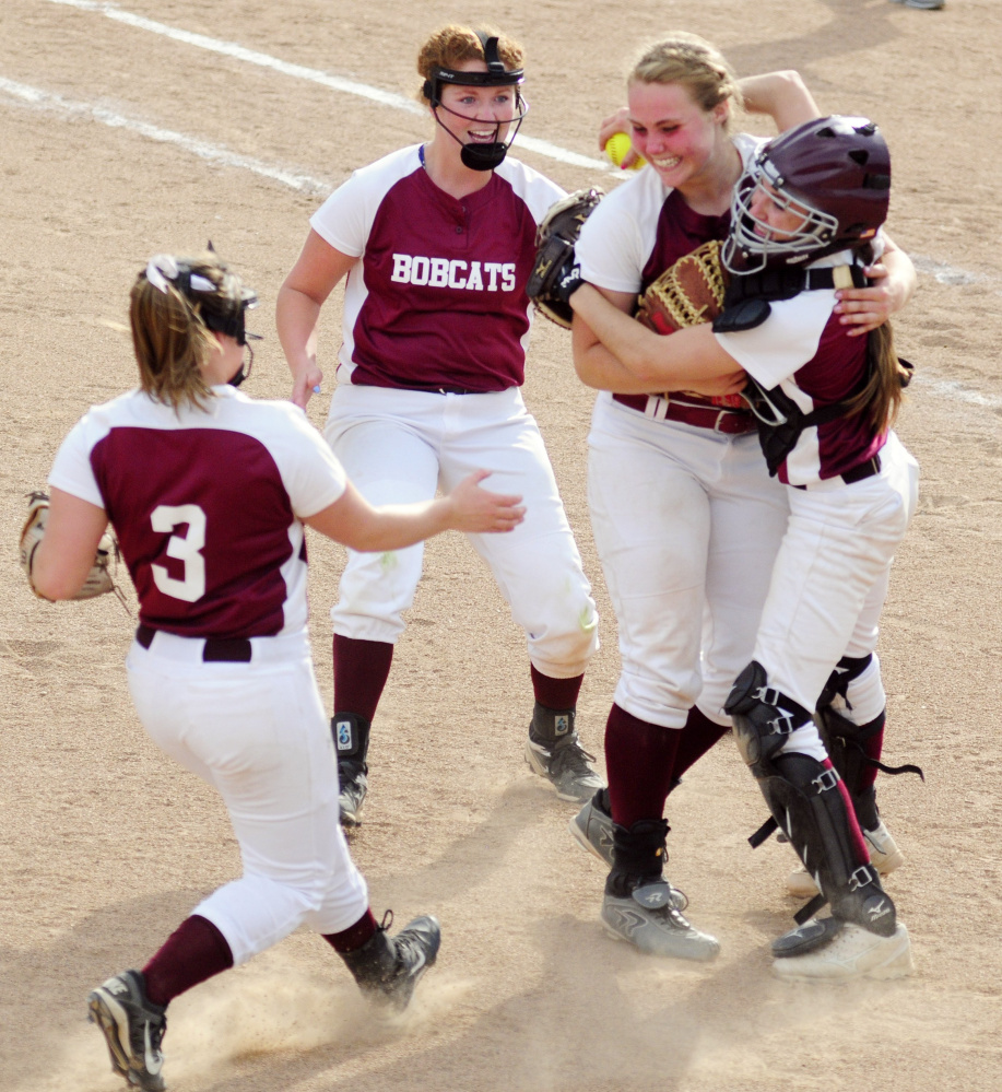 Staff photo by Joe Phelan Richmond players Camryn Hurley, left, Cassidy Harriman, Sidney Tilton and Meranda Martin celebrate after Richmond beat Greenville in the Class D South championship Tuesday at St. Joseph's College in Standish.