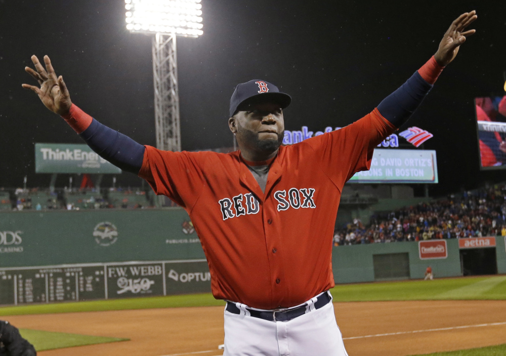 In this Sept. 30, 2016 photo, Boston Red Sox designated hitter David Ortiz waves to fans as he is honored before the a game against the Blue Jays at Fenway Park in Boston.