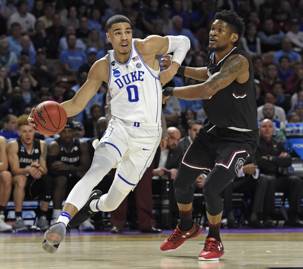 In this March 19 photo, Duke's Jayson Tatum, left, drives past South Carolina's Chris Silva during the first half of a second-round game of the NCAA tournament, in Greenville, South Carolina.