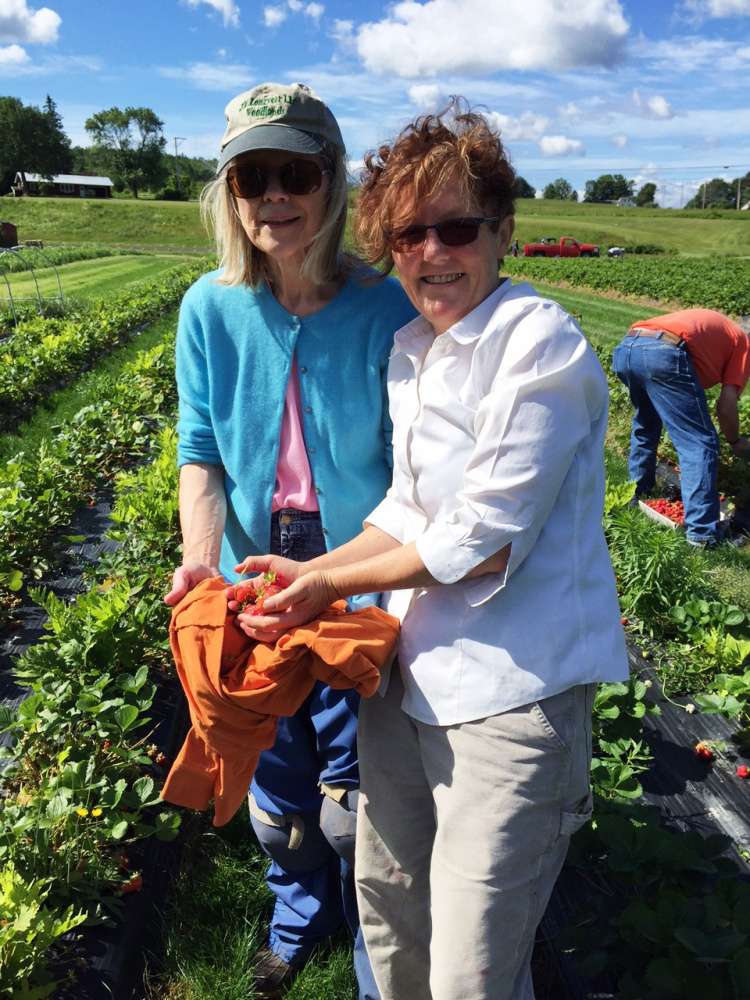 Old South Church pickers, Regina Longyear and Gretchen Legler, display the locally grown Pike's Farm strawberries to be served up on fresh baked biscuits and whipped cream from 10:30 a.m. to 12:30 p.m. Tuesday, July 4, on the Pierce House Lawn on Main Street in Farmington by the Old South Congregational Church.