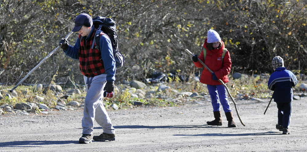 Matthew Perry emerges Nov. 19, 2014, from the Bond Brook Recreation Area with his daughter, Annmarie, 10, and son, Andrew, 4. The recreation area in Augusta will receive grant money to help improve the infrastructure at the park.