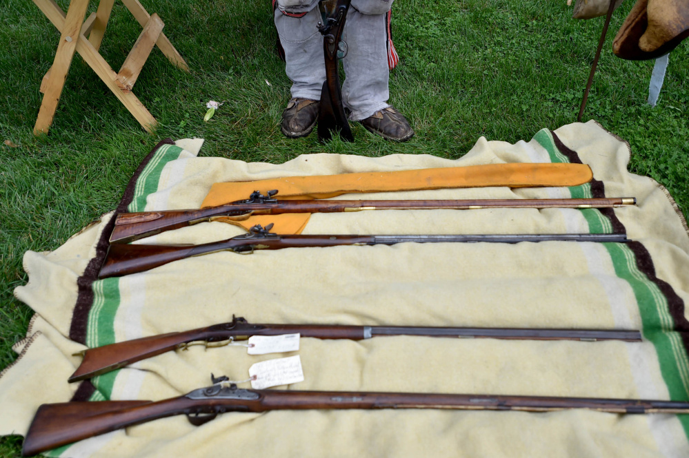Muskets lie on display Saturday at the annual Fort Halifax Days at Fort Halifax Park in Winslow.