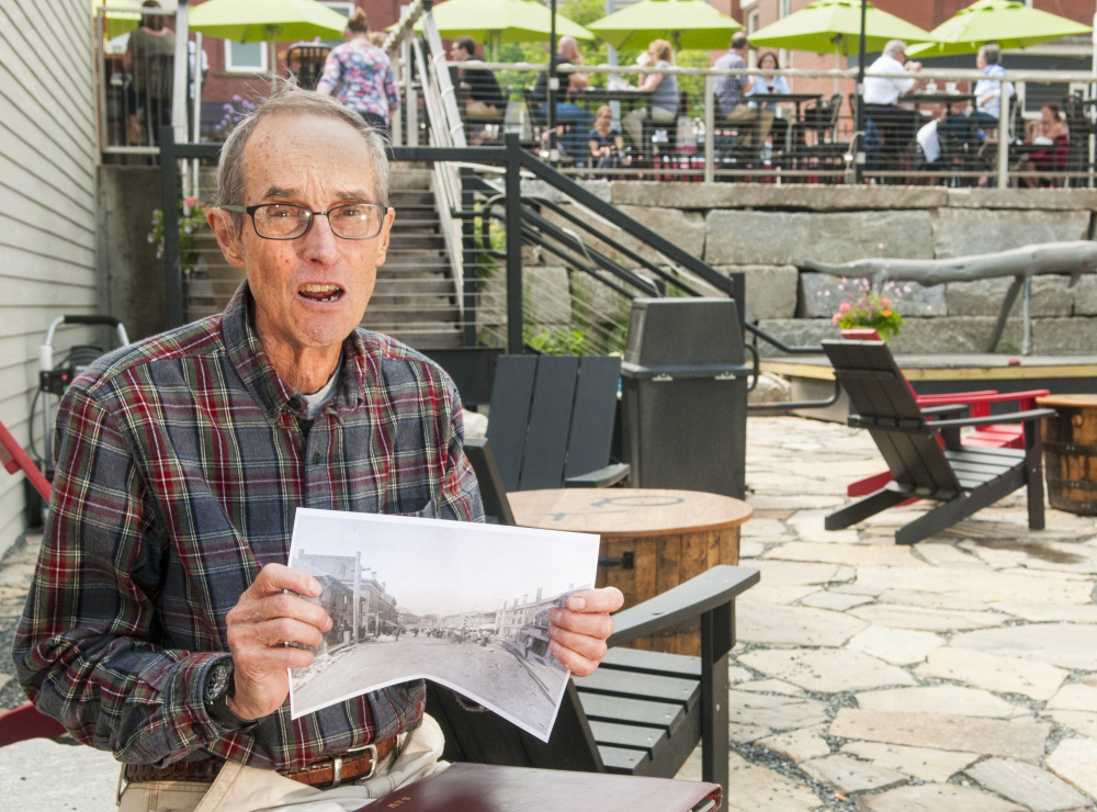 During an interview last week, Hallowell city historian Sam Webber talks about items from the old trolley line that ran through the city that were found during construction of the outdoor patio at the Quarry Tap Room in Hallowell.