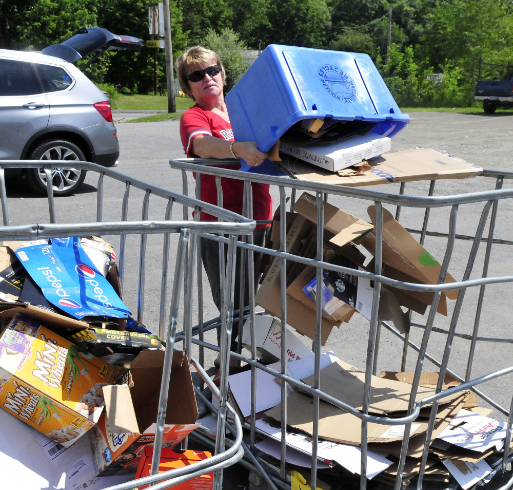 Doris Smith unloads cardboard in the appropriate bin Thursday at the Waterville Recycling Center on the Armory Road in Waterville.