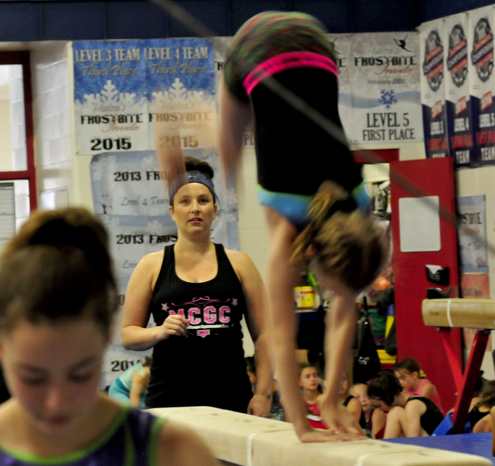Olympic gold medalist Carly Patterson watches a young gymnast work on a beam Thursday at the Alfond Youth Center in Waterville.