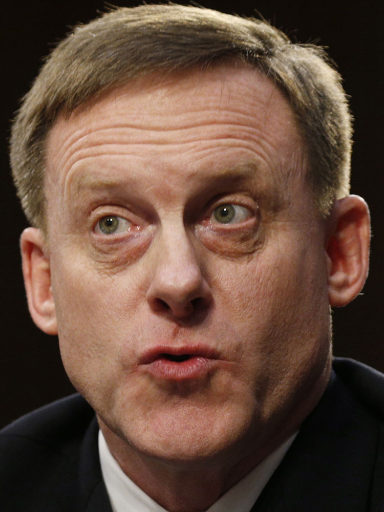 National Security Agency Director Michael Rogers testifies Wednesday before the Senate Intelligence Committee. Rogers wouldn't answer whether he was asked by President Trump to intervene in the FBI's investigation into Russia's possible involvement in last year's election.