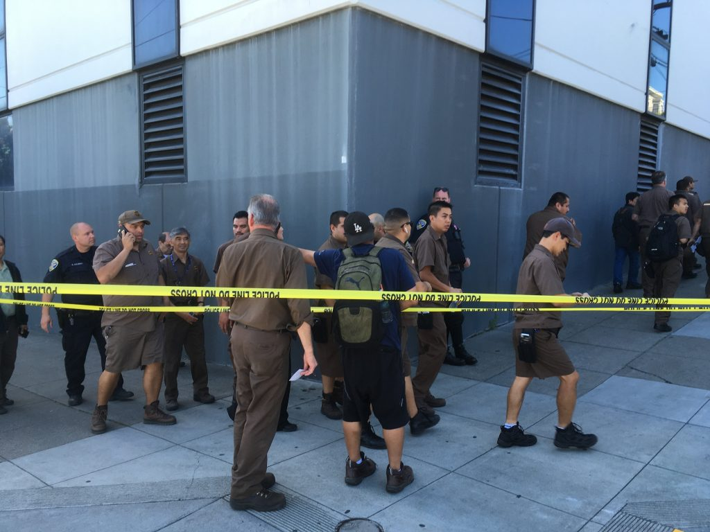 UPS workers gather outside after a shooting at a UPS warehouse and customer service center in San Francisco on Wednesday.