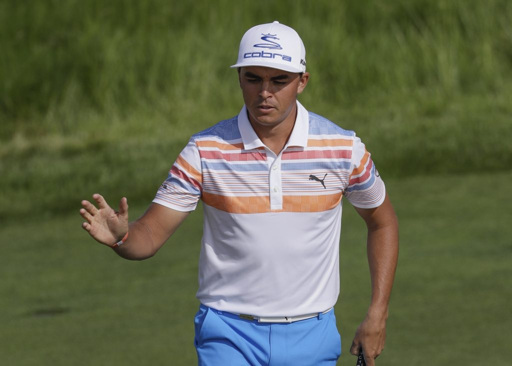 Rickie Fowler reacts after his birdie on the12th hole during the first round of the U.S. Open Thursday at Erin Hills in Erin, Wis.
