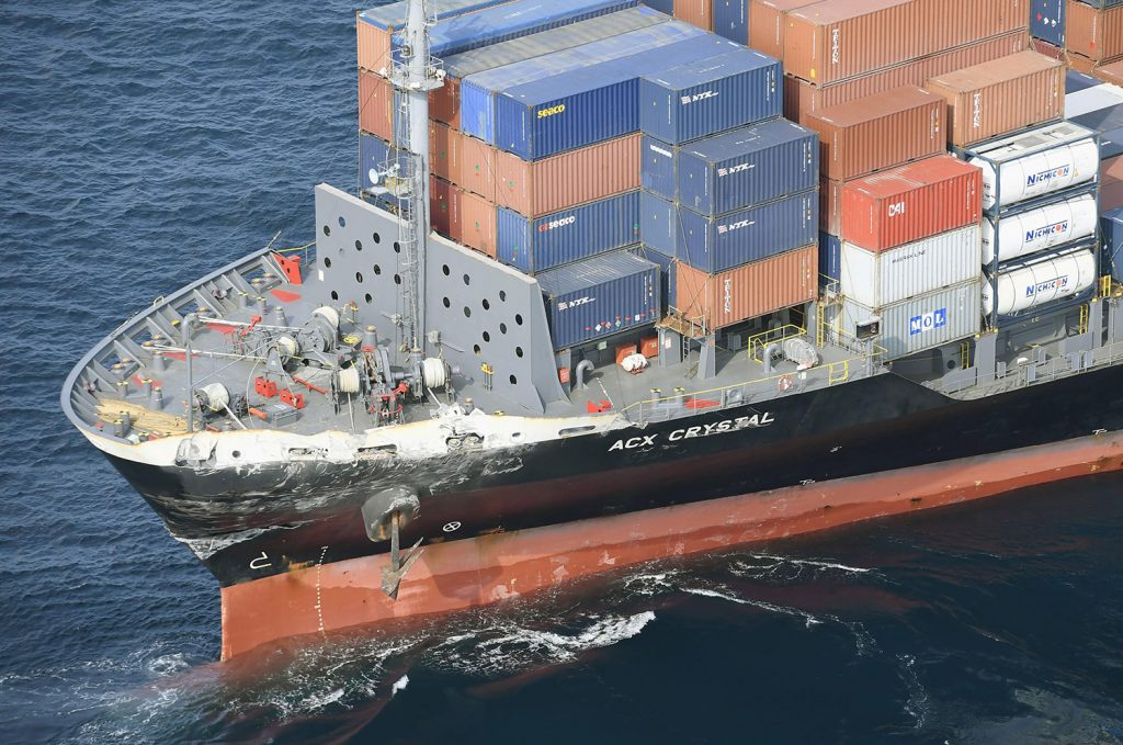 The damage to the Philippine-registered container ship ACX Crystal is seen off Izu Oshima, Japan, on Saturday.