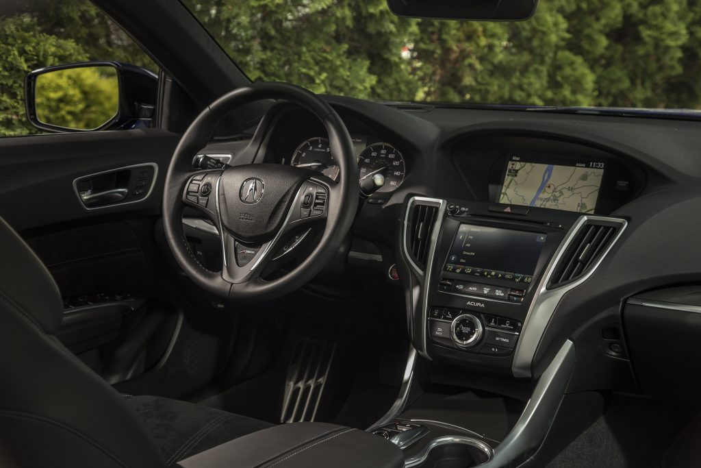 The 2018 Acura TLX includes a revised infotainment system that now includes Apple CarPlay and Android Auto compatibility, although the awkward dual screen set-up survives.