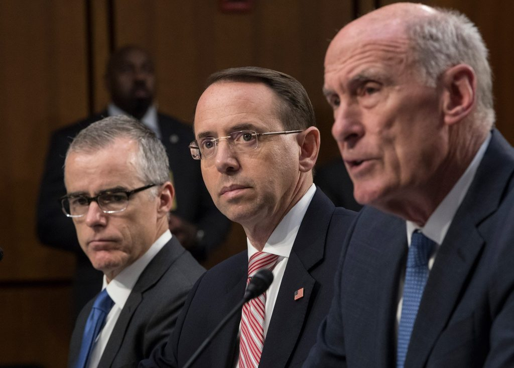 From left, acting FBI Director Andrew McCabe, Deputy Attorney General Rod Rosenstein, and Director of National Intelligence Dan Coats testify before a Senate Intelligence Committee hearing about the Foreign Intelligence Surveillance Act, on Capitol Hill on Wednesday.