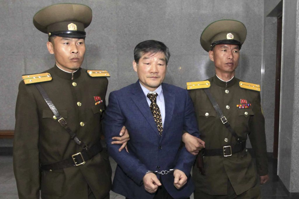 Kim Dong Chul is escorted to his trial on April 29, 2016, in Pyongyang. A North Korean court sentenced the Korean-American to 10 years in prison for what it called acts of espionage.
