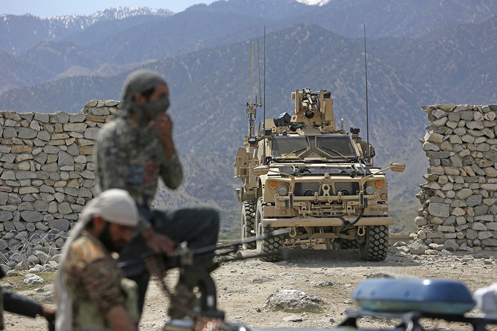 U.S. forces and Afghan security police patrol  near the site of a U.S. bombing in the Achin district of Jalalabad, east of Kabul, on April 17, 2017. The bulk of the additional U.S. troops will train and advise Afghan forces, according a Pentagon official.